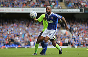 Ipswich Town striker David McGoldrick shields the ball during the Sky Bet Championship match between Ipswich Town and Brighton and Hove Albion at Portman Road, Ipswich, England on 29 August 2015.
