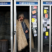 December 18, 2013 - Kiev, Ukraine: A man wearing traditional clothes talks on a mobile phone in Independence Square.<br /> On the night of 21 November 2013, a wave of demonstrations and civil unrest began in Ukraine, when spontaneous protests erupted in the capital of Kiev as a response to the government&rsquo;s suspension of the preparations for signing an association and free trade agreement with the European Union. Anti-government protesters occupied Independence Square, also known as Maidan, demanding the resignation of President Viktor Yanukovych and accusing him of refusing the planned trade and political pact with the EU in favor of closer ties with Russia.<br /> After a days of demonstrations, an increasing number of people joined the protests. As a responses to a police crackdown on November 30, half a million people took the square. The protests are ongoing despite a heavy police presence in the city, regular sub-zero temperatures, and snow. (Paulo Nunes dos Santos/Polaris)