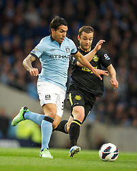 17.04.2013, Etihad Stadion, Manchester, ENG, Premier League, Manchester City vs Wigan Athletic, 29. Runde, im Bild Manchester City's Carlos Tevez in action against Wigan Athletic during the English Premier League 29th round match between Manchester City and Wigan Athletic at the Etihad Stadium, Manchester, Great Britain on 2013/04/17. EXPA Pictures © 2013, PhotoCredit: EXPA/ Propagandaphoto/ David Rawcliffe..***** ATTENTION - OUT OF ENG, GBR, UK *****