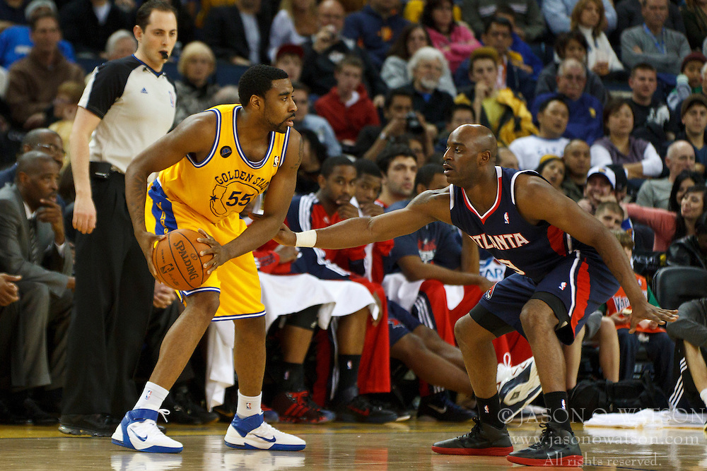 February 25, 2011; Oakland, CA, USA;  Golden State Warriors small forward Reggie Williams (55) is defended by Atlanta Hawks small forward Damien Wilkins (3) during the fourth quarter at Oracle Arena. Atlanta defeated Golden State 95-79.