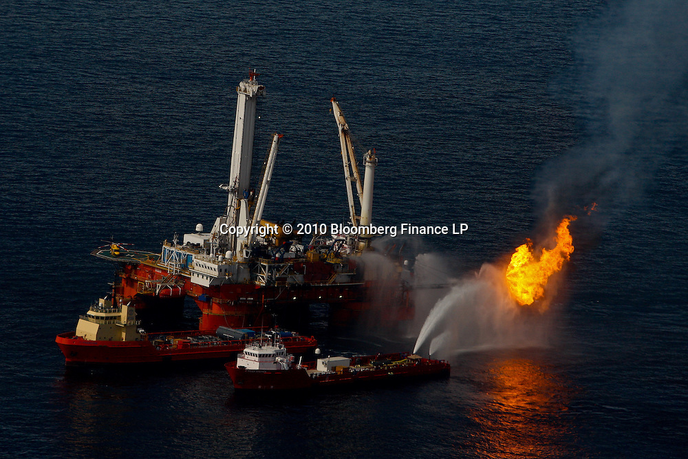 The BP Plc leased Q4000 vessel burns off all the oil and gas it collects at the site of the BP Plc Deep Water Horizon oil spill in the Gulf of Mexico off the coast of Louisiana, U.S., on Saturday, June 19, 2010. The BP Plc oil spill, which began when the leased Transocean Deepwater Horizon oil rig exploded on April 20, is gushing as much as 60,000 barrels of oil a day into the Gulf of Mexico, the government said. Photographer: Derick E. Hingle/Bloomberg