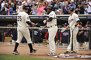 MINNEAPOLIS - SEPTEMBER 04:  Jim Thome #25 is greeted by Delmon Young #21 and J.J. Hardy #27 of the Minnesota Twins after Thome hit his first of two home runs against the Texas Rangers on September 4, 2010 at Target Field in Minneapolis, Minnesota.  The Twins defeated the Rangers 12-4.  (Photo by Ron Vesely)