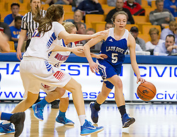 Buckhannon Upshur guard Courtney Reed (5) drives into a trap against Morgantown during a first round game at the Charleston Civic Center.