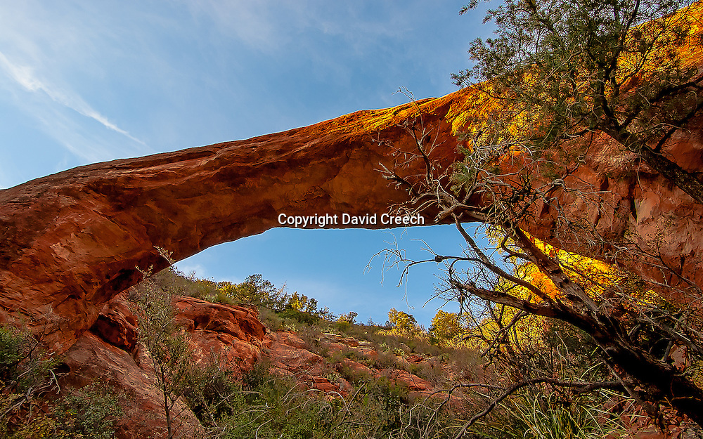 Vultee Arch in Sedona, Arizona shot from below.  Full color formatted to 16:9.