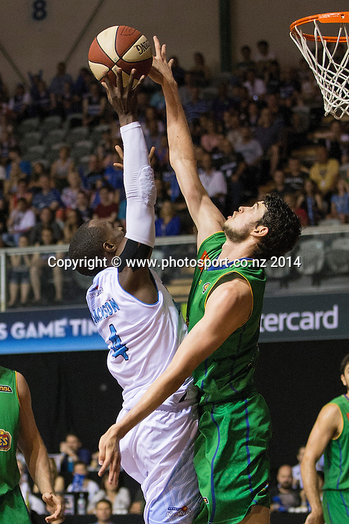 Breakers` Cedric Jackson and Crocodiles' Todd Blanchfield challenge for the ball in the game between SkyCity Breakers v Townsville Crocodiles. 2014/15 ANBL Basketball Season. North Shore Events Centre, Auckland, New Zealand, Friday, December 19, 2014. Photo: David Rowland/Photosport