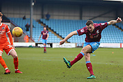 Scunthorpe United defender Murray Wallace (5) shoots at goal  during the EFL Sky Bet League 1 match between Scunthorpe United and Shrewsbury Town at Glanford Park, Scunthorpe, England on 17 March 2018. Picture by Mick Atkins.
