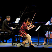 May 14, 2011 - Manhattan, NY : .The Damocles Trio, comprised of Airi Toshioka (violin), Sibylle Johner (cello) and Adam Kent (piano) perform Heitor Villa-Lobos's 'Trio No. 1' during Symphony Space's Wall to Wall Sonidos concert on Saturday night. .CREDIT: Karsten Moran for The New York Times