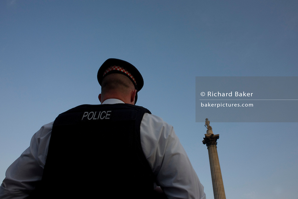 City of London Policeman on duty in Trafalgar Square during England v USA World Cup match.