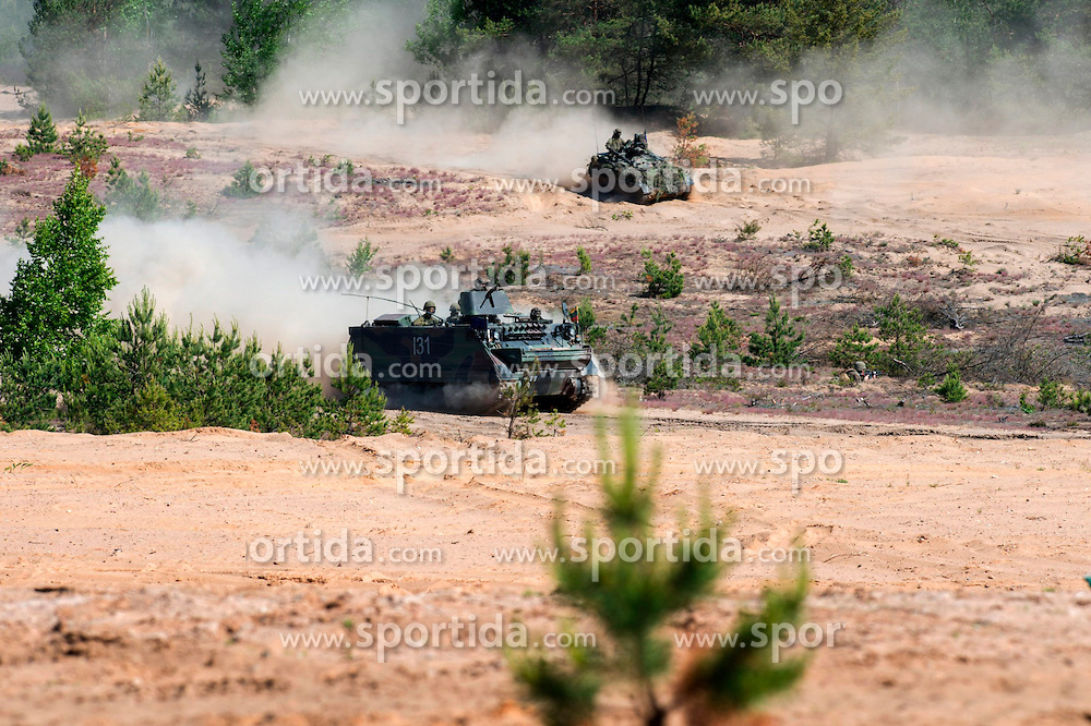 Military armored vehicles act in the second phase of Saber Strike 2015 multi-nation military exercises in Pabrade, Lithuania, June 12, 2015. The second phase of Saber Strike 2015 is held in Lithuania from June 8 till 19. EXPA Pictures &copy; 2015, PhotoCredit: EXPA/ Photoshot/ Alfredas Pliadis<br /> <br /> *****ATTENTION - for AUT, SLO, CRO, SRB, BIH, MAZ only*****