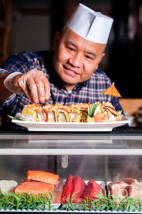 "Chef Gilbert ""Toto"" Decimo puts the perfect finishing touch on the Eel Twister Roll at Nakato's located in Springfield, MO."