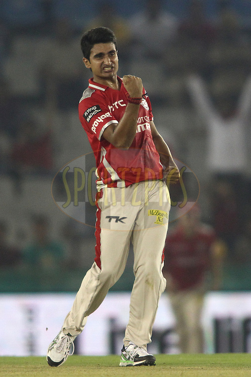 Karanveer Singh of the Kings XI Punjab celebrates getting Shoaib Malik of the Hobart Hurricanes wicket during match 2 of the Oppo Champions League Twenty20 between the Kings XI Punjab and the Hobart Hurricanes held at the Punjab Cricket Association Stadium, Mohali, India on the 18th September 2014<br /> <br /> Photo by:  Shaun Roy / Sportzpics/ CLT20<br /> <br /> <br /> Image use is subject to the terms and conditions as laid out by the BCCI/ CLT20.  The terms and conditions can be downloaded here:<br /> <br /> http://sportzpics.photoshelter.com/gallery/CLT20-Image-Terms-and-Conditions-2014/G0000IfNJn535VPU/C0000QhhKadWcjYs