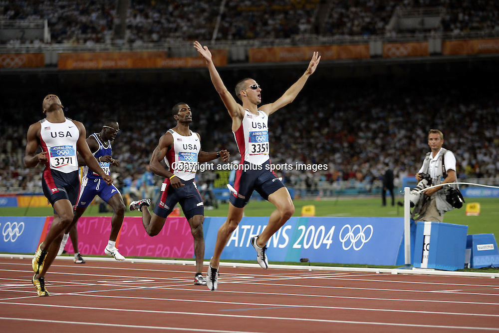 23 August 2004: American sprinter JEREMY WARINER (USA) celebrates as he crosses the finish line to win the the Men's 400m. Wariner won the Final in 40.00 seconds at The 2004 Olympic Games in Athens, Greece. <br />