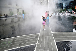 People interact with Pulse, a newly installed public art installation by artist Janet Echelman at the Dilworth Park's fountain, in Center City, Philadelphia, PA, on September 13, 2018. Compressed air and water mixture creates a mist effect and is programed to mimmic the movement of the subway lines underneath. The Center City located art work is intended to become a popular selfie spot, especially when lit vibrantly at night.