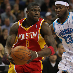 Jan 02, 2010; New Orleans, LA, USA; Houston Rockets guard Jermaine Taylor (8) drives past New Orleans Hornets guard Devin Brown (23) during the second quarter at the New Orleans Arena. Mandatory Credit: Derick E. Hingle-US PRESSWIRE
