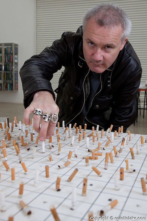 Damien Hirst portrait with work in progress. Photographed in his Chalford Studio, near Stroud, Gloucestershire