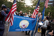 "Men from the New American Regeneration Party hold a banner reading ""Revolution generation debt is slavery""."