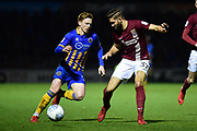 Shrewsbury Town midfielder Jon Nolan (20) looks to go by Northampton Town defender Jordan Turnbull (37) during the EFL Sky Bet League 1 match between Northampton Town and Shrewsbury Town at Sixfields Stadium, Northampton, England on 20 March 2018. Picture by Dennis Goodwin.