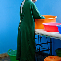 A midwife washes up before surgery in Motta