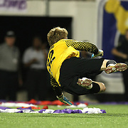 Harrisburg goaltender Chase Harrison (23) makes a save during a United Soccer League Pro soccer match between the Harrisburg City Islanders and the Orlando City Lions at the Florida Citrus Bowl on August 12, 2011 in Orlando, Florida. The Orlando City won the match 4-0 and Watson scored 3 goals. (AP Photo/Alex Menendez)
