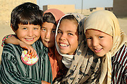 UNHCR returnees at Balkh-i Bastan, near Mazar-E Sharif, Balkh Province, Afghanistan, on Sunday, October 5, 2008.  ..Background:  Approximately 2,000 Hazara families have settled in an area called Balkh-I Bastan on the outskirts of Mazar. Most of them have returned from Iran.since 2002. UNHCR has assisted them with 153 shelters in 2005, 106 shelters in 2006, 25 shelters in 2007 and 53 shelters in 2008. Many of the returnees living in the area are involved in the labor market in Mazar. Returnees from Iran generally show a better level of education and marketable skills such as carpentry and construction, which they acquired in Iran..