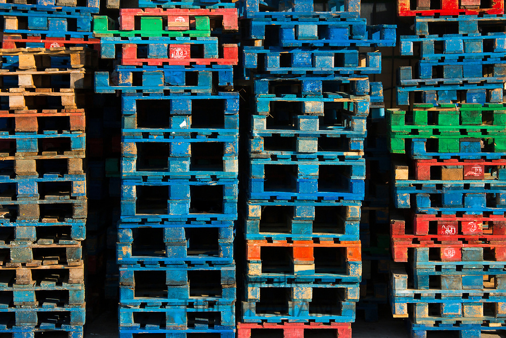 Bright colours of fishermen's pallets stacked at a fishing port in Cantabria, Northern Spain<br /> FINE ART PHOTOGRAPHY by Tim Graham