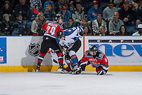 KELOWNA, CANADA - DECEMBER 7: Tyson Baillie #24 and Cole Martin #8 of the Kelowna Rockets check Austin Vetterl #15 of the Kootenay Ice on December 7, 2013 at Prospera Place in Kelowna, British Columbia, Canada.   (Photo by Marissa Baecker/Shoot the Breeze)  ***  Local Caption  ***