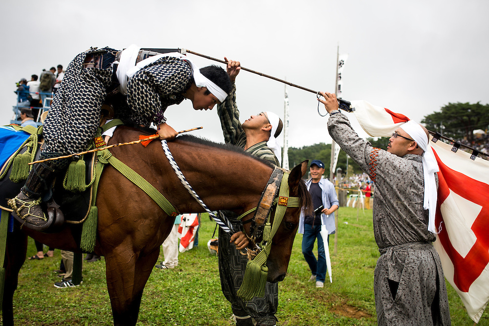 "MINAMISOMA, JAPAN - JULY 24 : A samurai horsemen prepares to compete in the Shinki-soudatsusen (sacred flag competition) during the Soma Nomaoi festival at Hibarigahara field on Sunday, July 24, 2016 in Minamisoma, Japan. ""Soma-Nomaoi"" is a traditional festival that recreates a samurai battle scene from more than 1,000 years ago.  (Photo: Richard Atrero de Guzman/NURPhoto)"