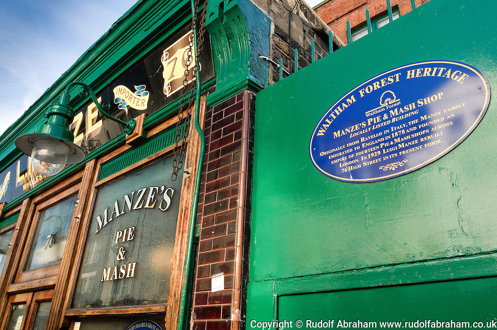 Manze's Pie & Mash Shop, Walthamstow, London E17, UK. The Manze family, who emigrated to England from Ravello in Italy in 1878, once owned some 14 pie and mash shops across London. Rebuilt in its present for in 1929, Manze's Pie and Mash Shop on Walthamstow High Street - already a locally listed building - became a Grade 2 Listed Building in 2013.