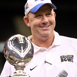 Dec 20, 2009; New Orleans, LA, USA; Middle Tennessee State Blue Raiders head coach Rick Stockstill stands next to the trophy following a win over the Southern Miss Golden Eagles in the 2009 New Orleans Bowl at the Louisiana Superdome. Middle Tennessee State defeated Southern Miss 42-32. Mandatory Credit: Derick E. Hingle-US PRESSWIRE