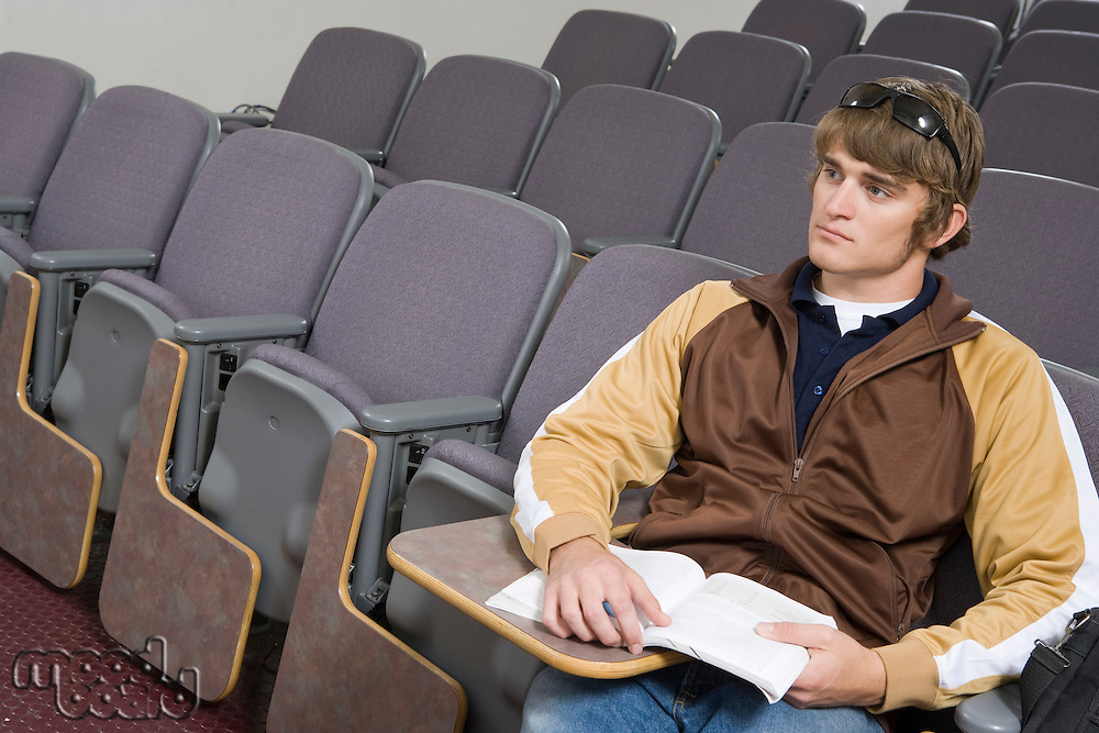 Male University student sitting in lecture hall