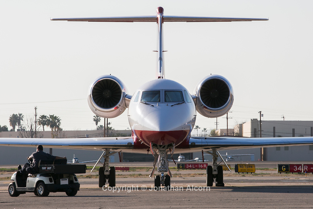 January 29, 2014 Van Nuys, CA  A Private Jet Services plane stands on the tarmac at Van Nuys Airport with a private jet that will be used to fly passengers to the Super Bowl this weekend.<br /> photo by Jonathan Alcorn for The Boston Globe
