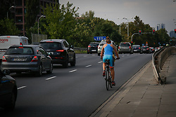 August 4, 2017 - Warsaw, Poland - A woman is seen cycling on a busy road in Warsaw, Poland on 4 August, 2017. (Credit Image: © Jaap Arriens/NurPhoto via ZUMA Press)