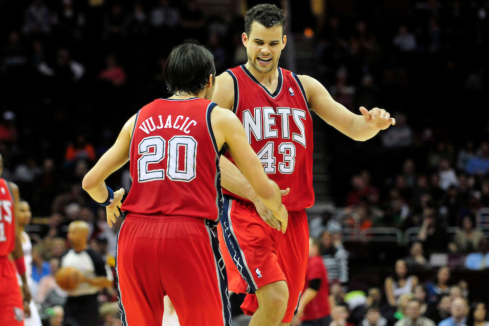 March 23, 2010; Cleveland, OH, USA; New Jersey Nets shooting guard Sasha Vujacic (20) celebrates with power forward Kris Humphries (43) during the final seconds of overtime against the Cleveland Cavaliers at Quicken Loans Arena. The Nets beat the Cavaliers 98-94 in overtime. Mandatory Credit: Jason Miller-US PRESSWIRE