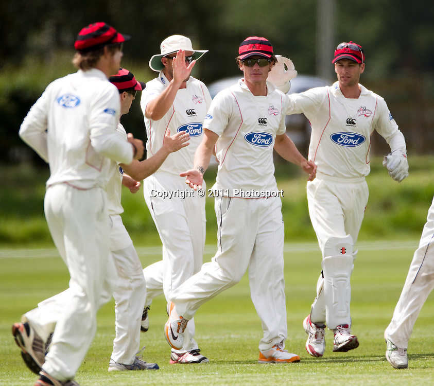 Canterbury player Rob Nicol is congratulated by team mates after taking a slips catch on day 2 of the 4 Day Plunket Shield cricket match between the Canterbury Wizards and Auckland Aces. Played on MainPower Oval in Rangiora, Canterbury. Tuesday 15 November 2011. Joseph Johnson/photosport.co.nz
