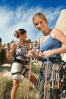 Climbers Tying Ropes Before Climb