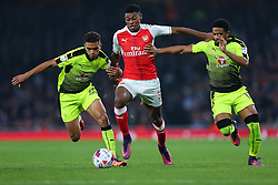 25 October 2016 - EFL Cup - 4th Round - Arsenal v Reading - Jeff Reine-Adelaide of Arsenal tangles with Tennai Watson and Garath McCleary of Reading - Photo: Marc Atkins / Offside.