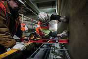 Construction workers in the new subway station being built as part of the extension of the 7 line of the New York subway system. The tunnel and the 34th street station is well on its way to be finished. A proposed extension to New Jersey is in the talks.
