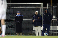 30 November 2013: UNC head coach Anson Dorrance (left) watches first half action with assistants Bill Palladino (center) and Chris Ducar (right). The University of North Carolina Tar Heels played the University of California Los Angeles Bruins at Fetzer Field in Chapel Hill, North Carolina in a 2013 NCAA Division I Women's Soccer Tournament Quarterfinal match. UCLA won the game 1-0 in two overtimes.