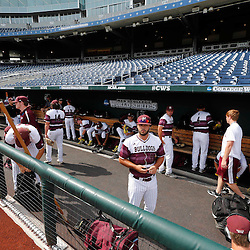 Jun 24, 2013; Omaha, NE, USA; Mississippi State Bulldogs players prepare in the dugout before game 1 of the College World Series finals against the UCLA Bruins at TD Ameritrade Park. Mandatory Credit: Derick E. Hingle-USA TODAY Sports