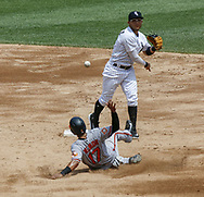 June 15, 2017 - Chicago, IL, USA - Chicago White Sox second baseman Yolmer Sanchez (5) throws to first as Baltimore Orioles shortstop Ruben Tejada (17) slides for a double play in the third inning at Guaranteed Rate Field Thursday, June 15, 2017 in Chicago. The White Sox won, 5-2. (Credit Image: © Jose M. Osorio/TNS via ZUMA Wire)