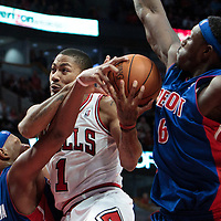 30 October 2010: Chicago Bulls Derrick Rose goes to the basket past Charlie Villanueva and Ben Wallace during the Chicago Bulls 101-91 victory over the Detroit Pistons at the United Center, in Chicago, Illinois, USA.
