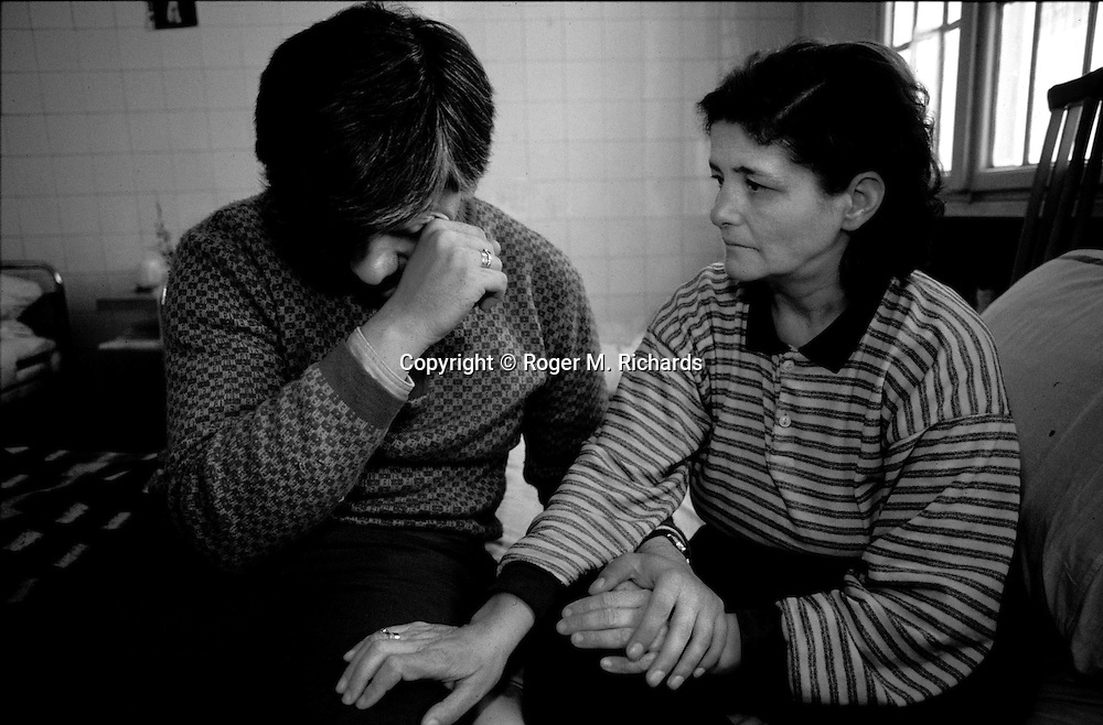 Mirko Horvat, 37, is comforted by his wife Rada, 46, at the Kosevo psychiatric clinic during the Bosnian Serb siege of Sarajevo, Bosnia and Herzegovina, April 1993. Rada Horvat tried to kill herself after her son was killed and she lost a leg when a Serb shell hit their home. Almost 2,000 children, and over 10,000 people in total were killed in Sarajevo during the 3-1/2 year siege. (Photo by Roger Richards)