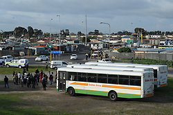 Cape Town - 180806 - Commuters wait for transport on the outskirts of Nyanga as all Golden Arorow bus services were suspended. Golden Arrow told commuters on their Facebook page that it had to suspend services into Delft and Nyanga and was now operating from the outskirts. At least two Golden Arrow buses were torched before sunrise on Monday morning, as hundreds of commuters battled to get to work. Taxi services were not operational after some associations went on strike on Monday morning. Picture: Henk Kruger/ANA/African News Agency