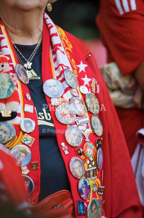 LIVERPOOL, ENGLAND - Wednesday, August 19, 2009: Badges on the scarf of a Liverpool supporter during the Premiership match at Anfield. (Pic by: David Rawcliffe/Propaganda)