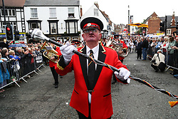 © Licensed to London News Pictures. 09/07/2016. Durham, UK. A bandmaster leads his band though Durham at the Durham Miners' Gala. The gala is a large gathering held annually associated with the coal mining heritage and trade unionism. Photo credit : Ian Hinchliffe/LNP