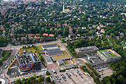 Nederland, Noord-Holland, Hilversum, 27-08-2013; Mediapark met Instituut voor Beeld en Geluid (li), VPRO-gebouw en dat van NTR-Vara. Middenboven in beeld het stadhuis van Hilversum.<br /> Business park of the public and commercial broadcasting companies,  the VPRO (green roof) and NTR-Vara buildings and the Netherlands Institute for Sound and Vision.<br /> luchtfoto (toeslag op standaard tarieven);<br /> aerial photo (additional fee required);<br /> copyright foto/photo Siebe Swart.