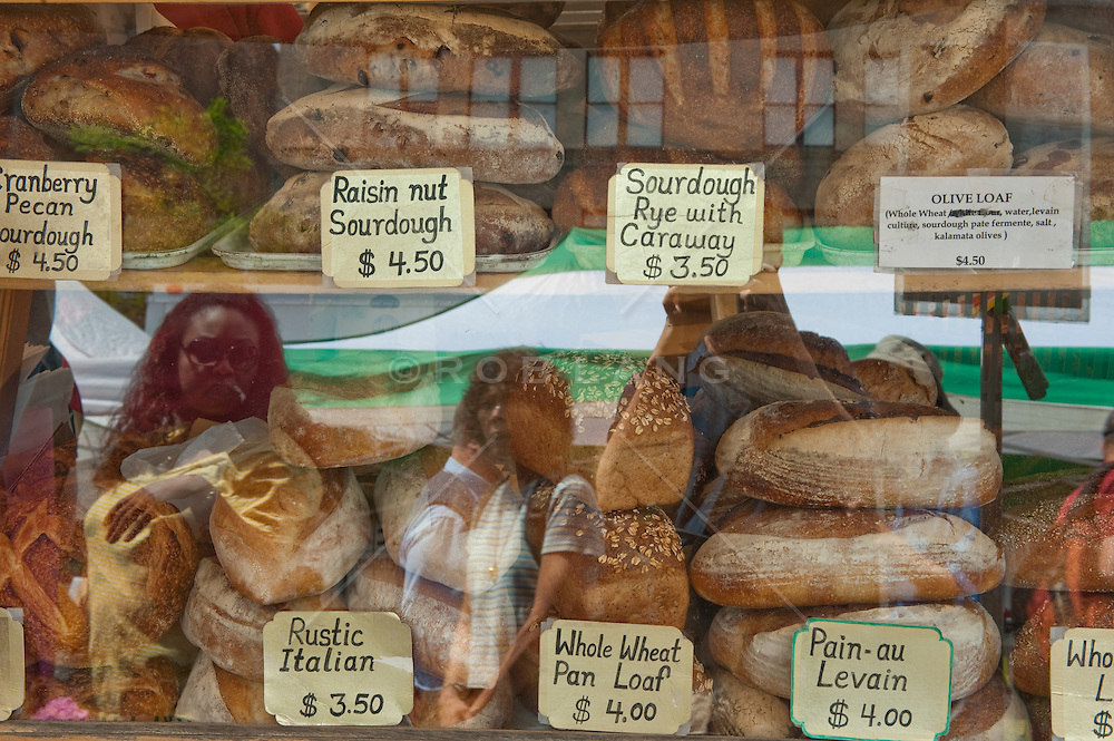 Bread In a window with people reflected in the glass