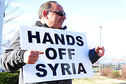 "4/6/2014 Allentown, PA. Nazih ""Nick"" Zarif Mouhrez of Catasauqua holds a protest sign. PA Members of the Lehigh Valley Syrian community gather at the corner of Airport Road and Union Boulevard in Allentown to protest against supporting terrorist groups in Syria.  Photo 