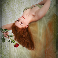 romantic pose of female lying back with a rose