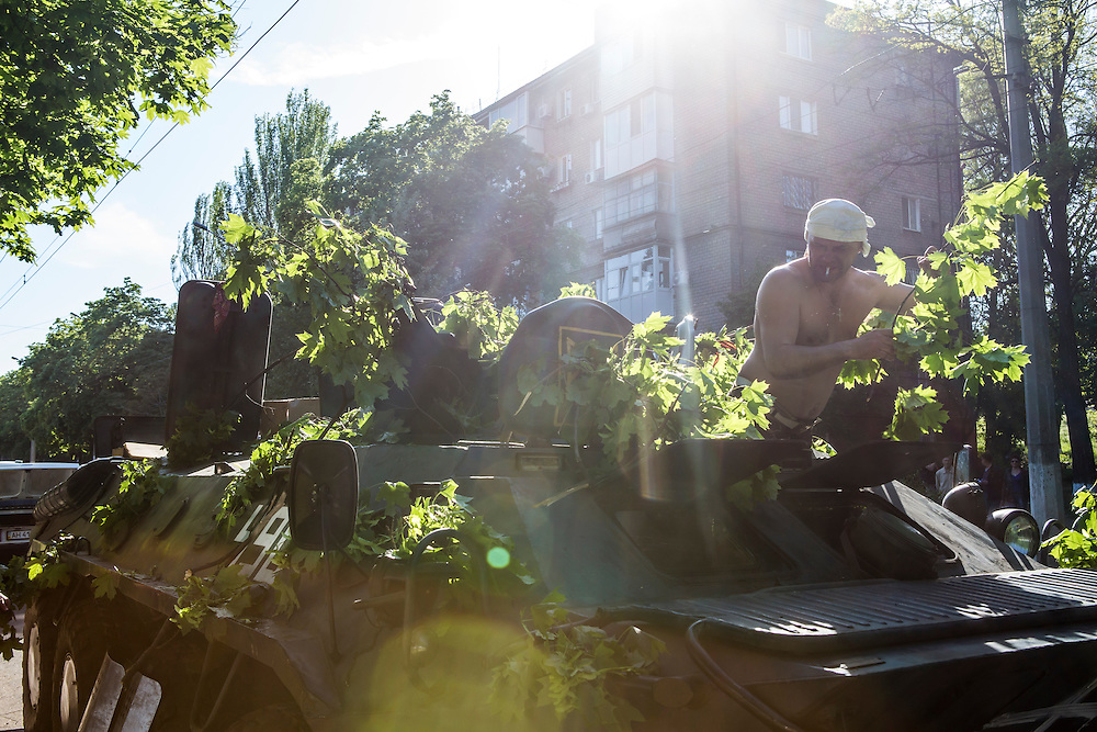 MARIUPOL, UKRAINE - MAY 10: People attempt to drive a commandeered armored personnel carrier a day after deadly clashes on May 10, 2014 in Mariupol, Ukraine. A referendum on greater autonomy is planned for the region tomorrow. (Photo by Brendan Hoffman/Getty Images) *** Local Caption ***